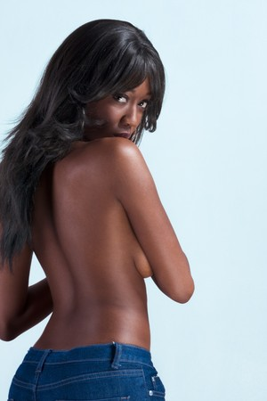 topless jeans: Beautiful shirtless ethnic black Afro American female covers her boobs by shoulder arm Stock Photo