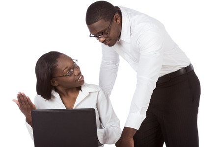 adult education of Ethnic black Afro American man and woman in glasses by laptop taking, discussing and solving problem trying to figure out some stuff Imagens