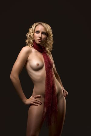 naked youth: Nude beautiful blond with curly hair standing with arm akimbo, breast forward. Fashion scarf is around her neck, go between her boobs, covering genitalia area Stock Photo
