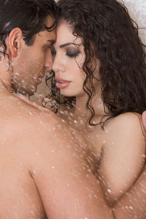 Loving affectionate nude young heterosexual couple in affectionate sensual kiss after taking shower. photo
