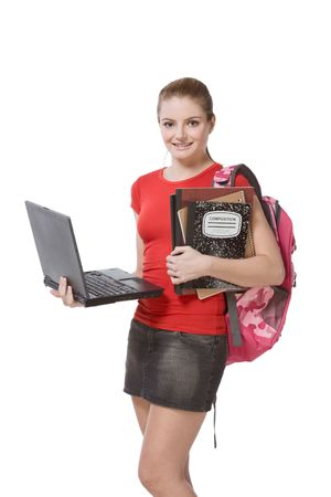 friendly Caucasian High school student schoolgirl with backpack, holding laptop computer, notebooks and composition book Stock Photo
