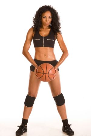 Fitness series sexy mid aged ethnic woman couch in sport clothes holding basketball ball Stock Photo - 4867112