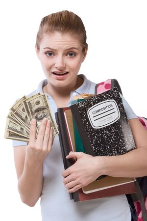 Young Caucasian schoolgirl with compositions notebook, copybooks and frustrated concern upset facial expression holds pile 100 dollar bills (one hundred) complaining about unaffordable tuition rise photo