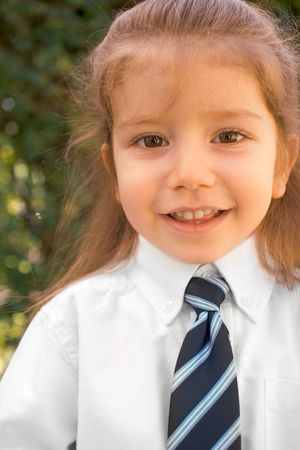 Almost 3 years old Jewish before opshernish ceremony with still uncut hair wearing white shirt and tie photo
