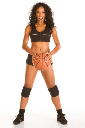 Fitness series sexy mid aged ethnic woman couch in sport clothes holding basketball ball and shouting photo