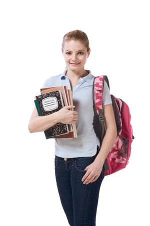 Friendly Caucasian High school girl student in jeans standing with backpack and holding books, notebooks and composition book Stock Photo - 5040086