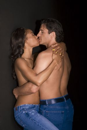 Loving affectionate nude interracial heterosexual couple in affectionate sensual kiss. Mid adult Caucasian men in late 30s and young black African-American woman in 20s Stock Photo - 5040075