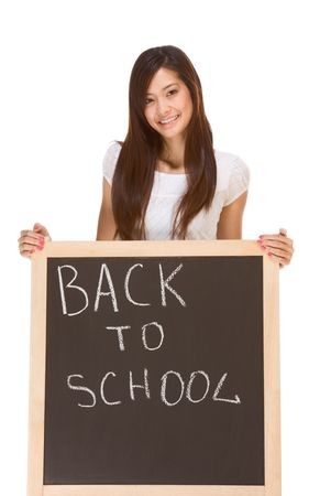 Friendly young ethnic High school girl of mixed Vietnamese and Chinese race student standing by chalkboard photo