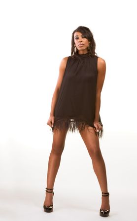 legs heels: Portrait of a beautiful black African American female with long legs in black dress
