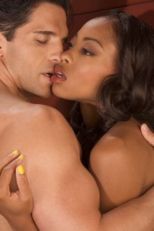 Loving affectionate nude heterosexual couple in affectionate sensual kiss. Mid adult Caucasian men in late 30s and young black African-American woman in 20s Stock Photo - 5216430