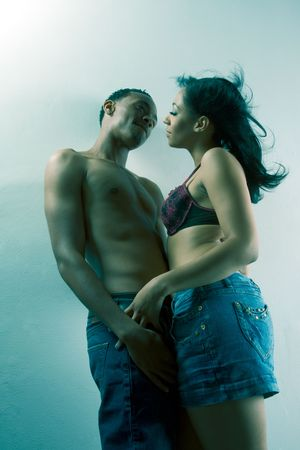 Loving ethnic black African-American young affectionate heterosexual couple