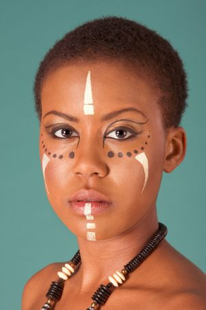 Portrait of African American woman wearing original tribal themed face-paint and necklace
