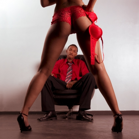 nude black women: Striptease exotic dancer performing for ethnic African American business man (focus is on panties) Stock Photo