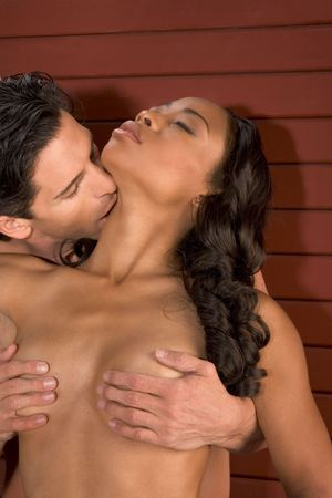 Loving affectionate nude Interracial heterosexual couple in affectionate sensual kiss. Mid adult Caucasian men in late 30s and young black African-American woman in 20s Stock Photo - 5458947