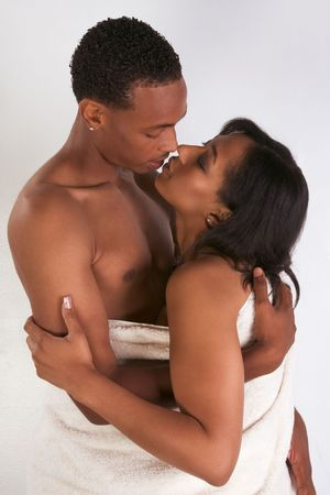 man and woman sex: Black sensual couple, African American man and woman of Creole ethnicity hugging wrapped in bathtowel