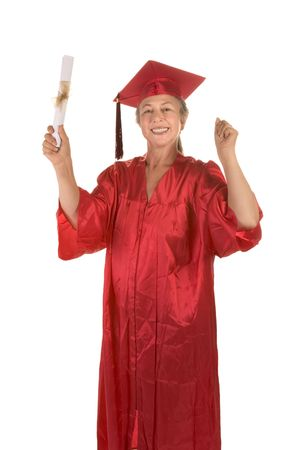 Adult education - senior Caucasian female college graduate student with diploma in her hand. Crimson color of gown indicates major in Journalism Banco de Imagens
