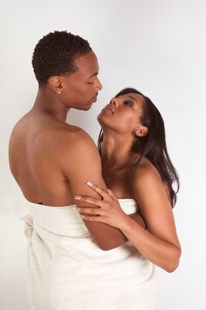 Black sensual couple, African American man and woman of Creole ethnicity hugging wrapped in bathtowel Stock Photo - 5577369