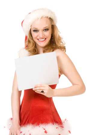 Blond sensual pinup woman in Christmas Mrs Santa Claus outfit and black thigh high leather boots holding sheet of white paper. Can be used as greeting card or your text or additional graphics can be added according to needs. photo