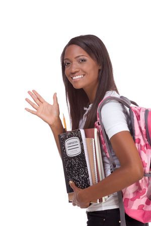 brunnet: education series - Friendly ethnic black female high school student with backpack and composition book, gesturing and greeting