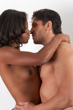 Loving affectionate nude interracial heterosexual couple in affectionate sensual kiss. Mid adult Caucasian men in late 30s and young mulatto biracial female mix of black African American, Native American and German ethnicity in 20s Stock Photo - 5645241