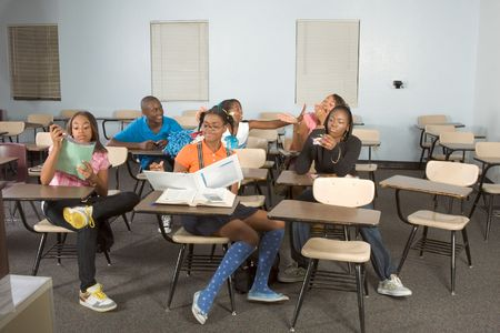 chaos: High school classroom with six children, one boy and five girls, making chaos