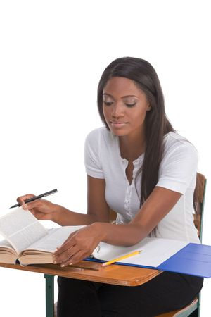 English spelling-bee contest education series - ethnic black female high school student studying dictionary preparing for test, exam or spelling bee contest Stock Photo
