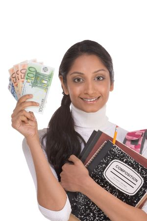Ethnic Indian college student with compositions notebook, copybooks and backpack holds pile 100 (one hundred), 50 (fifty) and 20 (twenty) euro bills happy getting money help to subsidies costly university cost