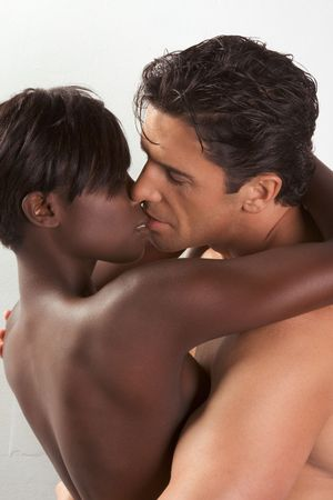 Loving affectionate nude heterosexual couple in sensual kiss and hug. Mid adult Caucasian men in late 30s and young black African-American woman in 20s Stock Photo - 5707056