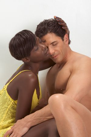 afro american nude: Happy young ethnic black African American woman and mid aged Caucasian man in bed interacting and making love