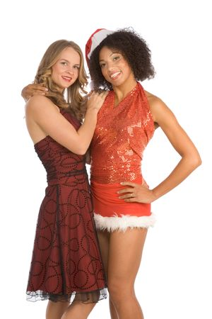 Two lesbian friend lovers female one Caucasian and second ethnic Latina in Mrs. Santa Claus are in friendly hug