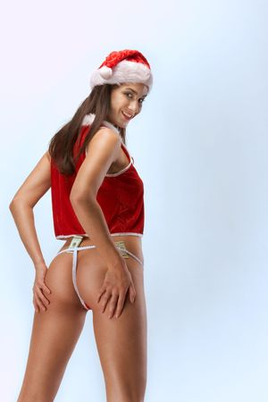 Sensual woman stripper in Mrs Santa Claus costume and Santa hat with tips money tucked under her underwear lingerie panties Stock Photo - 5831185