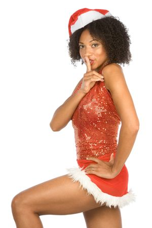 Dark skinned middle aged gesturing woman in sexy Christmas outfit asking for Silence, with finger on her lips photo