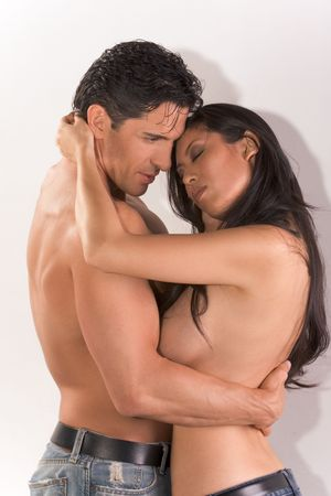 Loving affectionate nude multiethnic heterosexual couple in affectionate sensual hug. Mid adult Caucasian men in late 30s and young black African-American woman in 20s Stock Photo - 5981830