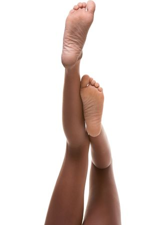 Beautiful slim legs and feet of ethnic black Afro-American female Stock Photo - 6025228