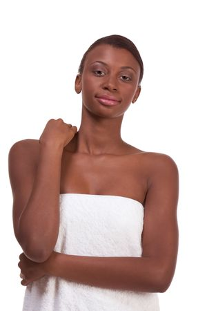 Beautiful young Afro American female with Slicked Back Hair wrapped in white bath towel preparing for sauna photo