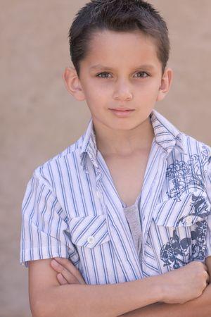 the sleeve: Headshot of elementary age kid in short sleeve shirt