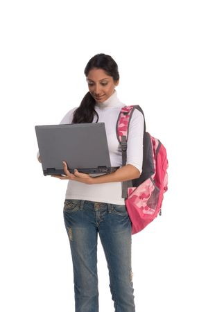 education series template - Friendly ethnic Indian woman high school student typing on portable computer photo