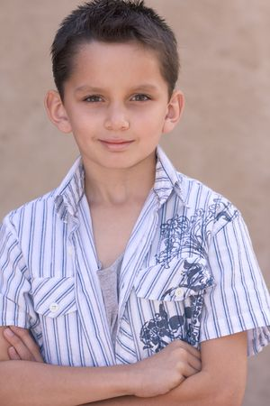 the sleeve: Headshot of elementary age kid in short sleeve shirt. Multi-ethnic of Caucasian and Hispanic (Mexican) mix