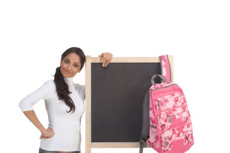 Friendly Indian college student woman with backpack by chalkboard Stock Photo - 6229872