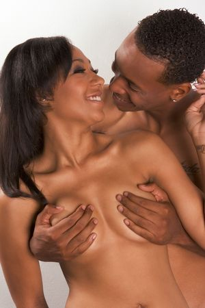Loving ethnic black African-American young affectionate nude heterosexual couple in affectionate sensual kiss Stock Photo - 6229987