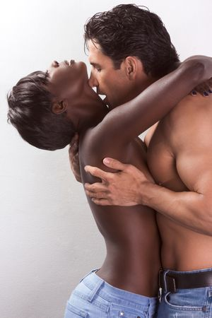 Loving affectionate nude heterosexual couple in sensual kiss and hug. Mid adult Caucasian men in late 30s and young black African-American woman in 20s Stock Photo - 6229993