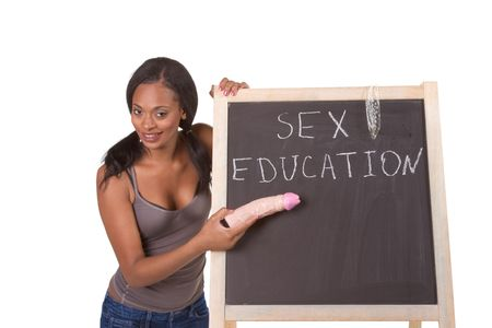 Young ethnic black female college student with vibrator by school chalkboard. Can be used as template for sex education themed posters or invitations Banque d'images