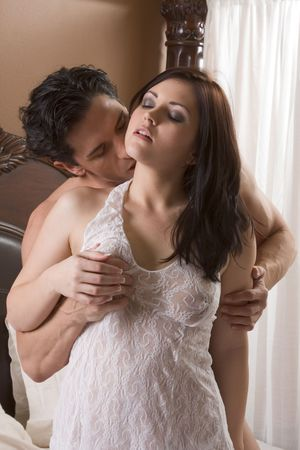 Young sexy naked heterosexual couple making love in bed Stock Photo - 6292811