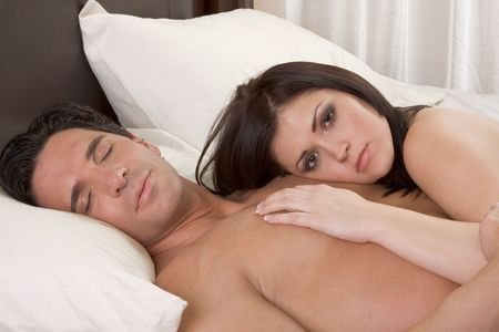 Young sexy naked heterosexual couple in love sleeping in bed Stock Photo - 6292888
