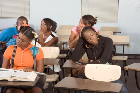 High school classroom with six children, one boy and five girls, making chaos Stock Photo - 6357661