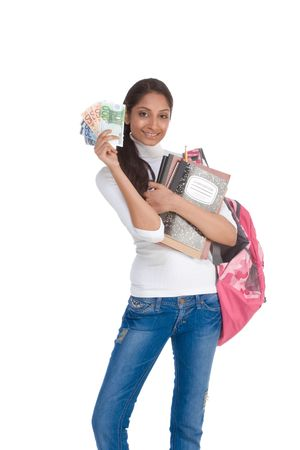 Ethnic Indian college student with compositions notebook, copybooks and backpack holds pile 100 (one hundred), 50 (fifty) and 20 (twenty) euro bills happy getting money help to subsidies costly university cost photo