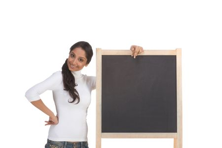 Friendly Indian college student woman by chalkboard photo