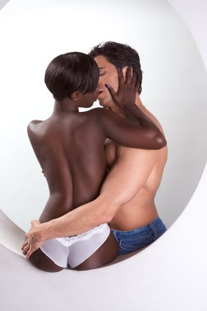 african american nude: Loving affectionate nude heterosexual couple in sensual hug. Mid adult Caucasian men in late 30s and young black African-American woman in 20 Stock Photo