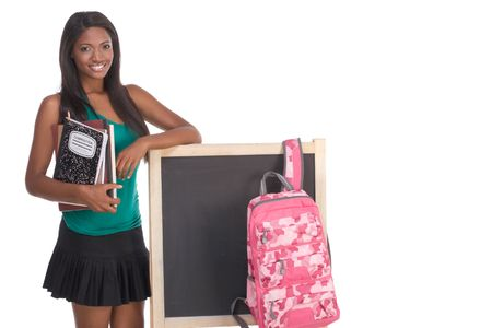education series template - Friendly ethnic black woman high school student by chalkboard Stock Photo - 6388116