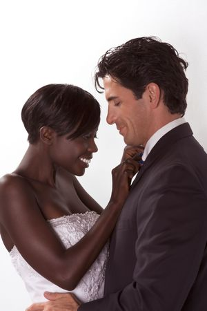 mixed age: romantic newlywed young ethnic black African American woman and mid aged Caucasian man Stock Photo